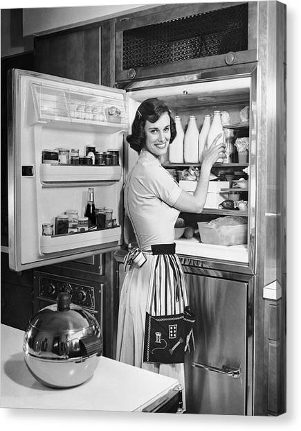 House Wife Removing Milk From Refrigerator Canvas Print by George Marks