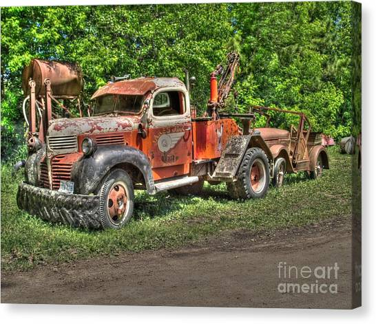 In Tow Canvas Print by Jimmy Ostgard
