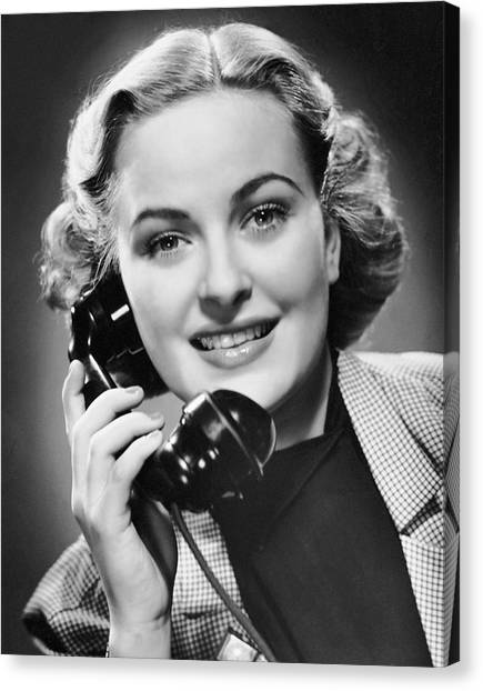 Indoor Portrait Of Woman On Telephone Canvas Print by George Marks