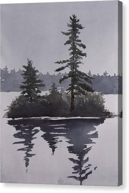 Island Reflecting In A Lake Canvas Print by Debbie Homewood