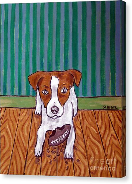 Jack Russell Terrier With A Football Toy by Jay Schmetz