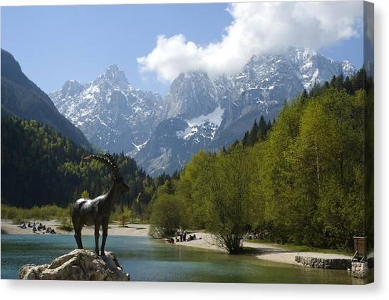 Jasna Lake In Julian Alps With Statue Of Mythical Chamois Zlatorog Canvas Print by John Elk III