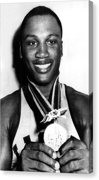 Joe Frazier Canvas Print - Joe Frazier Holding Olympic Heavyweight by Everett