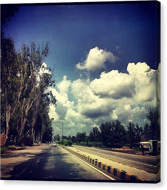 Om Canvas Print - Journey Of Life... #road #clouds by Om Bhatia