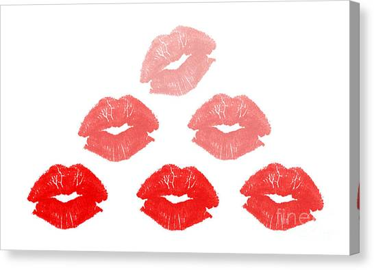 Kisses In Pyramid Shape Canvas Print by Blink Images