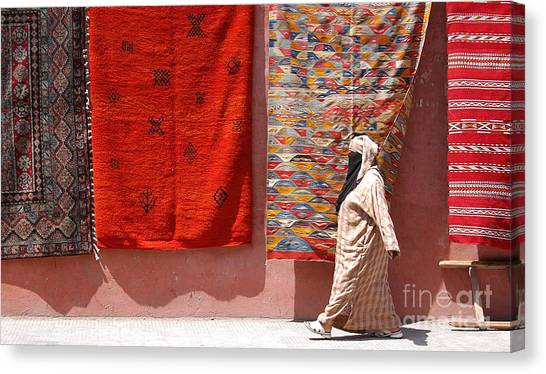 Lady And The Carpets Canvas Print by Steve Goldstrom
