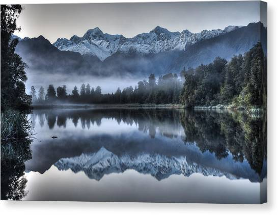 Fox Glacier Canvas Print - Lake Matheson In Predawn Winter Light by Colin Monteath
