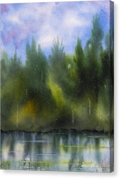 Lake Reflecting Trees Canvas Print by Debbie Homewood