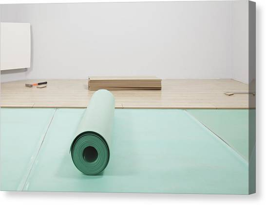 Laying A Floor. A Roll Of Underlay Or Canvas Print by Magomed Magomedagaev
