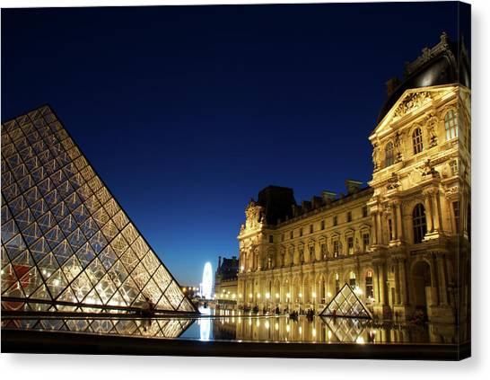 Le Louvre Canvas Print - Le Louvre In Paris At Night by Andre Distel