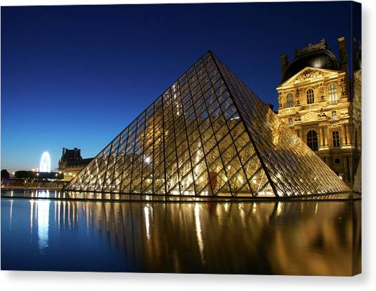 Le Louvre Canvas Print - Le Louvre Reflections Of The Pyramid by Andre Distel