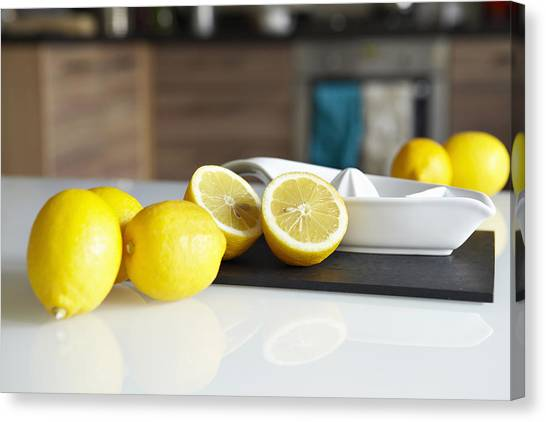 Lemons Canvas Print - Lemons And Juicer On Kitchen Counter by Debby Lewis-Harrison