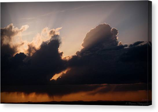 Light Rays And Rainy Skies Canvas Print by Aaron Burrows