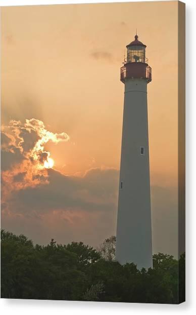 Lighthouse Sunset Canvas Print by Tom Singleton