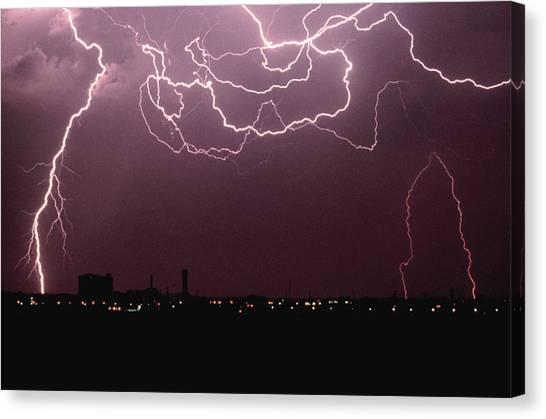 Lightning Over City Canvas Print by John Foxx
