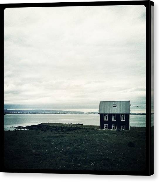House Canvas Print - Little Black House By The Sea by Luke Kingma