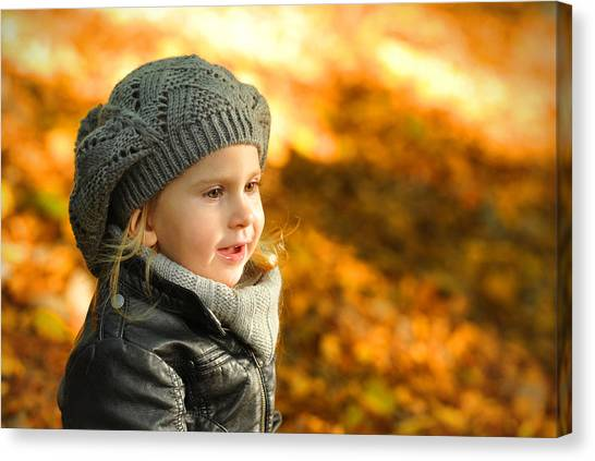 Little Girl In Autumn Leaves Scenery At Sunset Canvas Print by Waldek Dabrowski