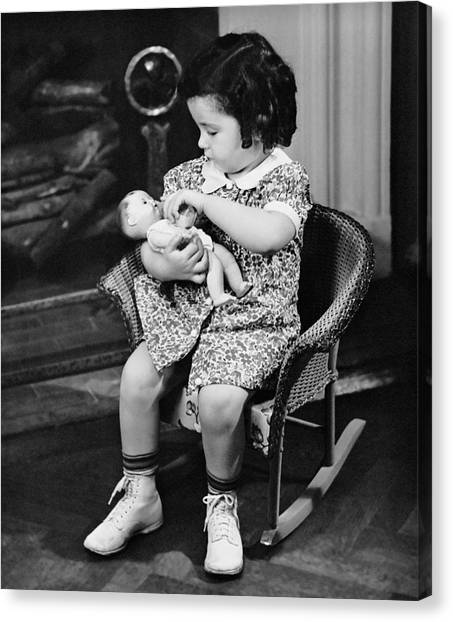 Little Girl Playing With Doll Canvas Print by George Marks