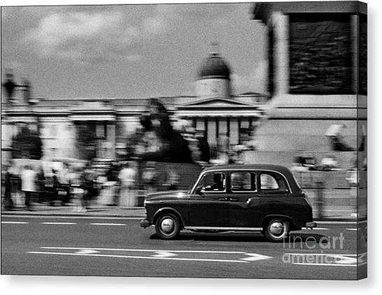 London Cab In Trafalgar Square Canvas Print by Aldo Cervato