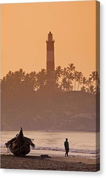 Lone Person Walking Along Lighthouse Beach In Early Morning Canvas Print by Anders Blomqvist