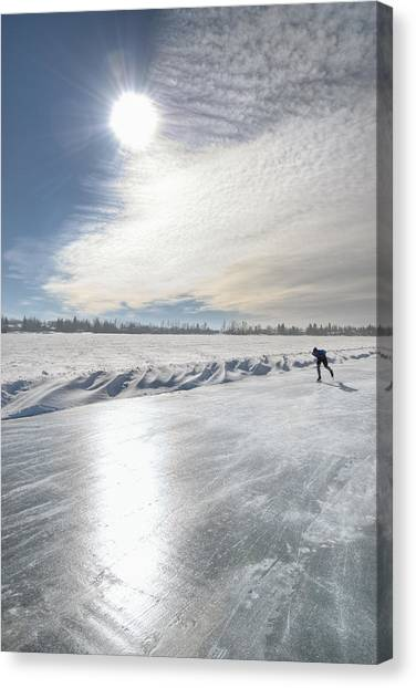 Speed Skating Canvas Print - Lone Speed Skater On Sylvan Lake by Jerry Kobalenko
