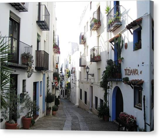 Lovely Narrow Street And Balconies Decorated With Plants In Peniscola Spain Canvas Print