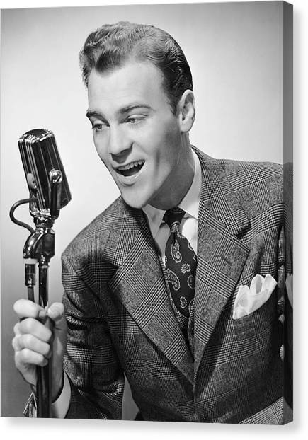 Male Singer Holding Microphone Canvas Print by George Marks
