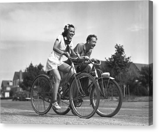 Man And Woman Riding Bicycles, (b&w), Canvas Print by George Marks