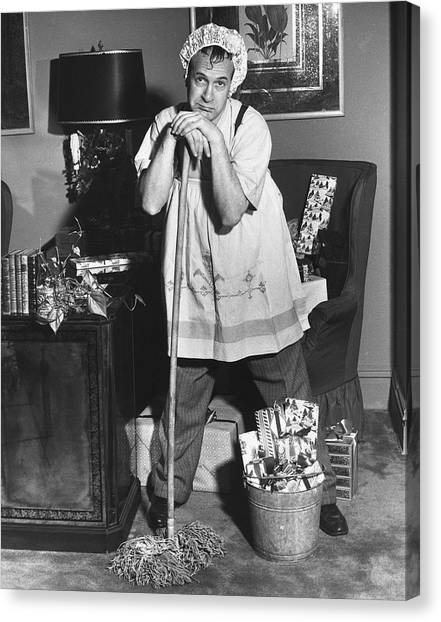 Man Dressed As Cleaning Woman In Office Canvas Print by George Marks