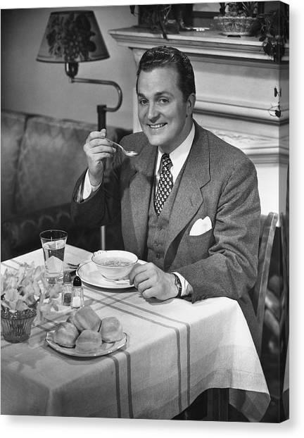 Man Having Dinner Canvas Print by George Marks