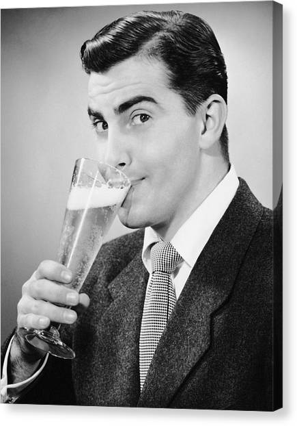 Man In Suit Drinking Tall Glass Of Beer Canvas Print by George Marks