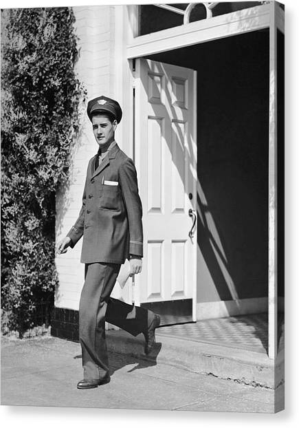 Man In Uniform Walking Out Door Canvas Print by George Marks