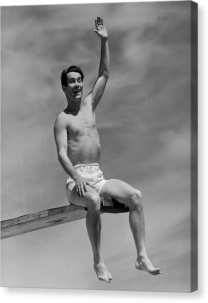Man On Diving Board Canvas Print by George Marks