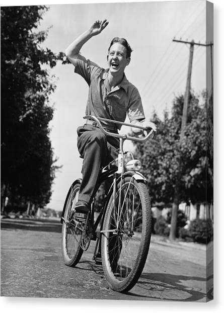 Man Riding Bicycle, Waving, (b&w) Canvas Print by George Marks