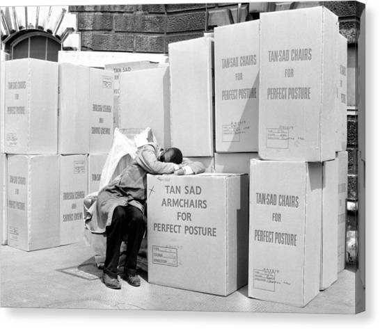 Man Sleeping On Box Outdoors (b&w) Canvas Print by Hulton Archive