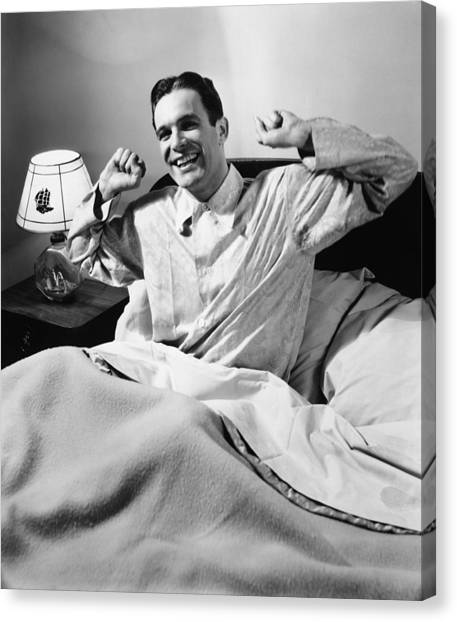 Man Stretching In Bed, (b&w), Canvas Print by George Marks