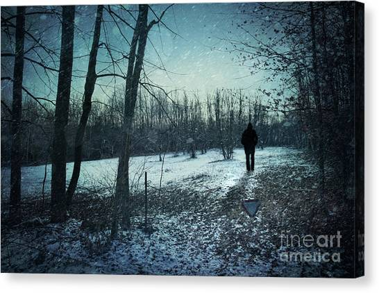 Foggy Forests Canvas Print - Man Walking In Snow At Winter Twilight by Sandra Cunningham