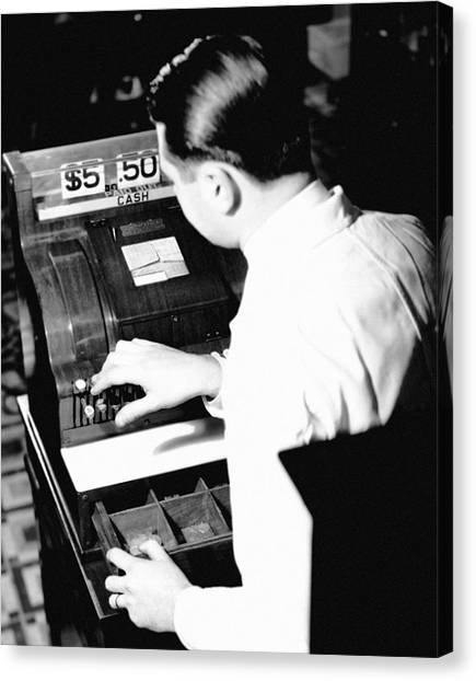 Man Working At Register Canvas Print by George Marks