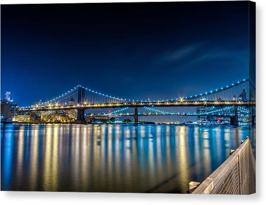 Manhattan Bridge And Light Reflections In East River. Canvas Print