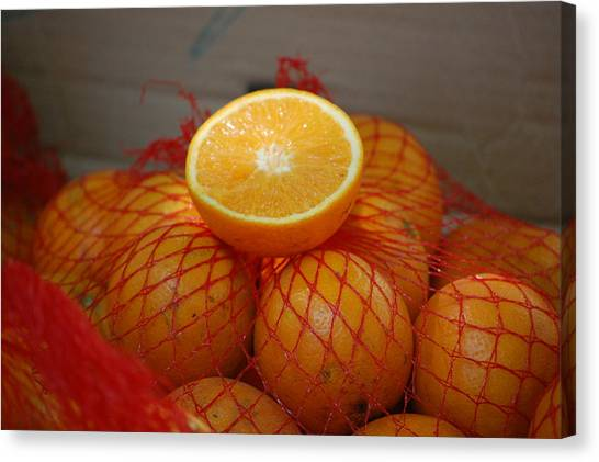 Market Oranges Canvas Print by Dickon Thompson