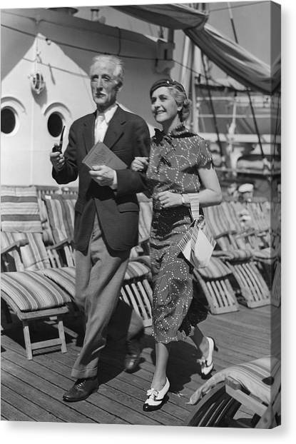 Mature Couple On Deck Of Boat Canvas Print by George Marks