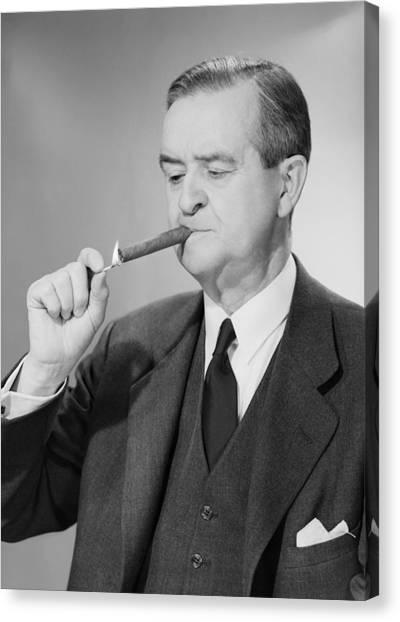 Mature Man Lighting Cigar Canvas Print by George Marks