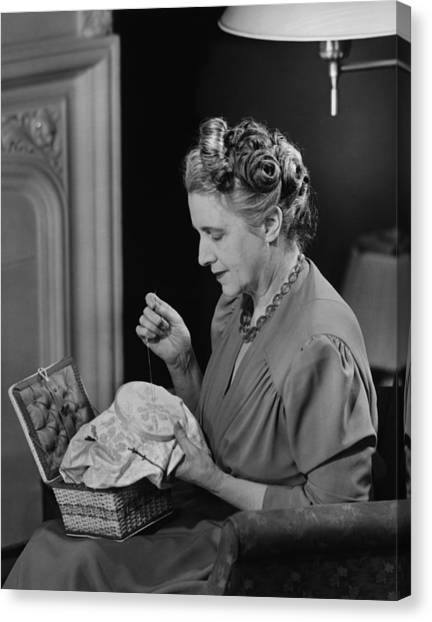 Mature Woman Sitting In Living Room, Doing Needlepoint, (b&w) Canvas Print by George Marks