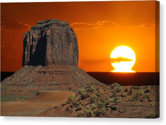 Melting Into The Horizon At Monument Valley National Park Canvas Print