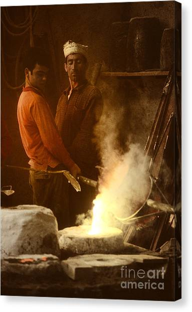 Men Pouring Bronze Canvas Print by Ed Rooney