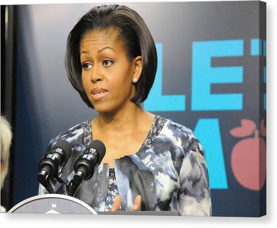 Michelle Obama Presents The Childhood Canvas Print by Everett