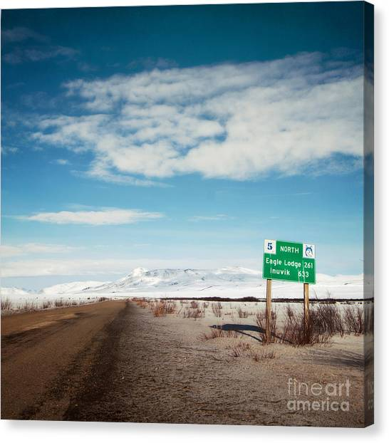 Street Signs Canvas Print - Milepost At The Dempster Highway by Priska Wettstein
