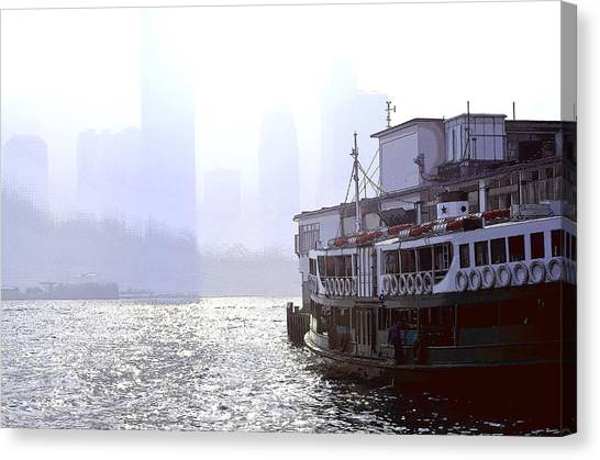 Mist Over Victoria Harbour Canvas Print by Enrique Rueda