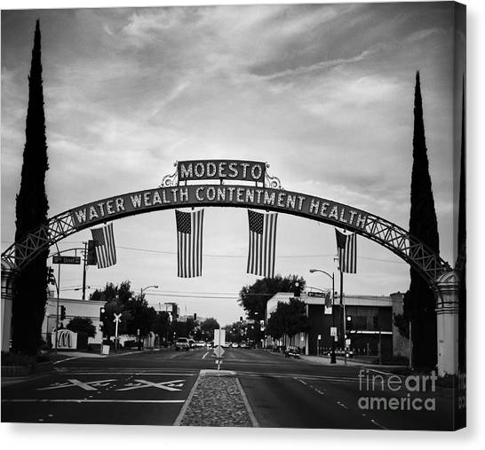 Modesto Arch With Flags Canvas Print