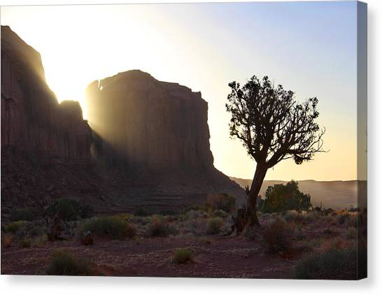Desert Sunsets Canvas Print - Monument Valley At Sunset by Mike McGlothlen